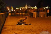 Travel photography:Beggar on Charles Bridge, Czech Republic
