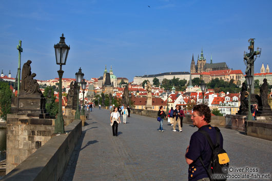 Tourists on the Charles Bridge with the Prague castle in the background