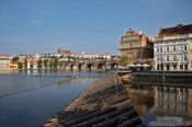 Travel photography:View of Charles Bidge with Moldau (Vltana) river, Smetana museum, and the Prague castle in the background, Czech Republic