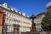 Travel photography:Houses and fountain in Prague`s Old Town, Czech Republic