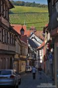Travel photography:Street in Barr with vineyards in the background, France