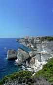 Travel photography:Bonifacio coastline showing the city atop the cliffs, France