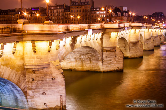 View of the Pont Neuf (new bridge) across the Seine river by night