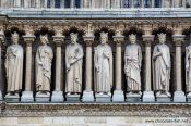 Travel photography:Facade detail of Notre Dame cathedral in Paris, France