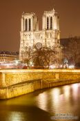 Travel photography:View of river Seine with Notre Dame cathedral by night, France