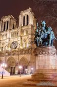 Travel photography:View of Notre Dame cathedral with Charlemagne monument, France