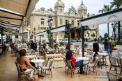 Travel photography:The Cafe Paris in front of the Monte Carlo Casino, Monaco