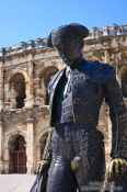Travel photography:Torero sculpture Nimes  in front of the coliseum, France