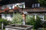 Travel photography:Traditional house with water fountain in Garmisch-Partenkirchen, Germany