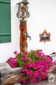 Travel photography:Water fountain with flowers in Garmisch-Partenkirchen, Germany