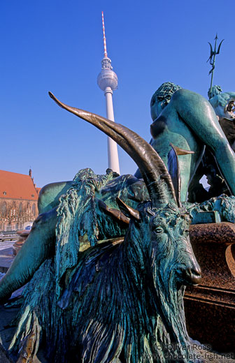 Neptunbrunnen (Neptune`s fountain) on Berlin`s Alexanderplatz with St.-Marien Kirche and Fernsehturm in the background