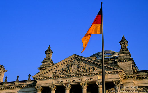 The Reichstag with glass cupola and flag