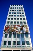 Travel photography:Building featuring mosaic with socialist theme at the Alexanderplatz, Germany
