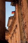 Travel photography:Reichstag facade detail with flag, Germany