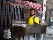 Travel photography:Bratwurst seller outside the Friedrichstrasse station in Berlin, Germany