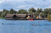 Travel photography:Bathers in Lake Constance near the Neolithic stilt houses in Unteruhldingen, Germany