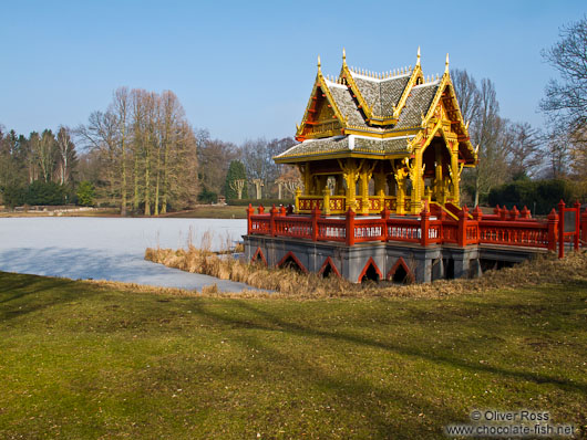Frozen lake with Thai pavilion at the Tierpark Hagenbeck zoo in Hamburg