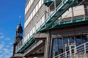 Travel photography:The Gruner & Jahr publishing house with tower of St. Michaelis church (Michel) in Hamburg, Germany
