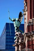 Travel photography:Archangel Michael above the portal of St. Michaelis church in Hamburg (Michel), Germany