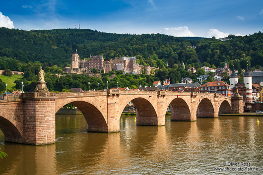 View of Heidelberg's old bridge across the Neckar River with the castle in the background