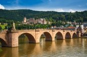 Travel photography:View of Heidelberg's old bridge across the Neckar River with the castle in the background, Germany