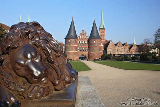 Resting lion outside Lübeck`s Holstentor (city gate)