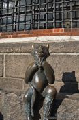 Travel photography:Devil sculpture outside the Marienkirche (St. Mary`s church) in Lübeck, Germany