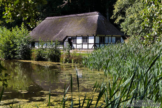 18th century half-timbered house by a lake