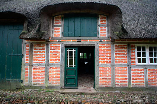 18th century Frisian house with typical roof and half-timbered brick facade