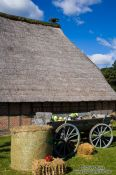 Travel photography:Typical 18th century Frisian farm house with cart, Germany