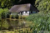 Travel photography:18th century half-timbered house by a lake , Germany