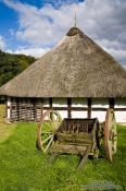 Travel photography:Cart outside an 18th century Frisian house, Germany