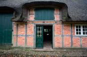 Travel photography:18th century Frisian house with typical roof and half-timbered brick facade , Germany