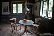 Travel photography:Table with chairs, an 18th century farm house living room, Germany