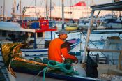 Travel photography:Firsherman in Iraklio (Heraklion) harbour, Grece