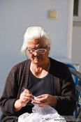 Travel photography:Woman knitting in a village near Garazo, Grece