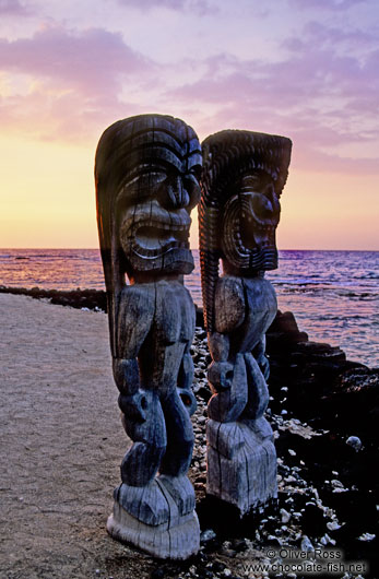 Two guardians at Pu`uhonua o Honaunau during sunset
