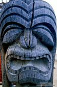 Travel photography:Face of one of the guardians at Pu`uhonua o Honaunau, Hawaii USA