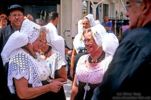 Men and women in traditional dress at a festival in Vlissingen