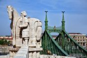 Travel photography:The Freedom Bridge with statue of King Stefan I (founder of Hungary), Hungary