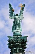 Travel photography:The archangel Gabriel atop the Millennium column on Budapest´s Heros´ Square, Hungary