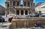 Travel photography:Budapest opera house with beggar , Hungary