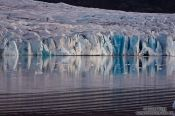 Travel photography:Edge of the Vatnajökull glacier calving into Breiðárlón lake, Iceland