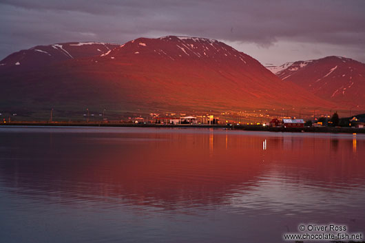 Midnight sun on midsummer night over the fjords at Akureyri