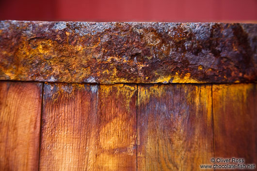 Detail of the rusty rim of a barrel outside the Siglufjörður herring museum