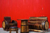 Travel photography:Table and chair ensemble from old herring barrels at a cafe in Siglufjörður, Iceland