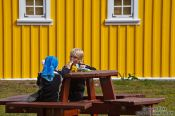 Travel photography:Kids enjoying and ice cream cone at the Siglufjörður camp site, Iceland