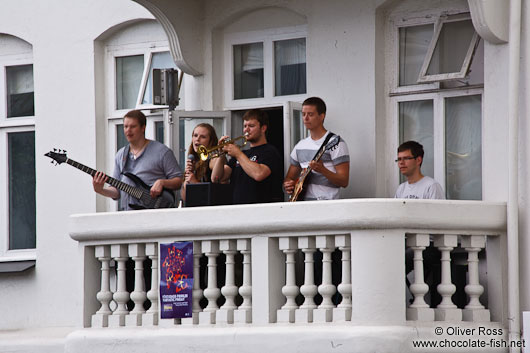 Live music performance in downtown Reykjavik performed on a balcony