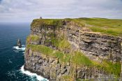 Travel photography:The Cliffs of Moher with O'Brien's tower, Ireland