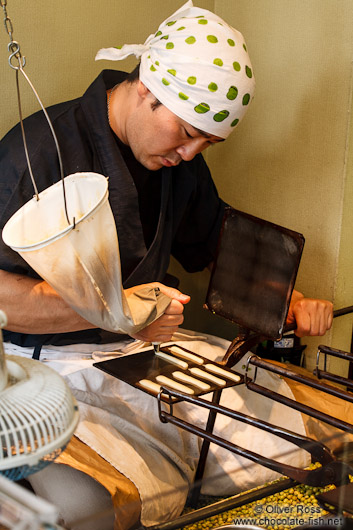 Preparing small biscuits in a street bakery in Kyoto´s Gion district